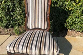 An old Victorian prayer chair recovered in a velvet stripe