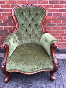 Old Victorian buttoned back chair reupholstered and recovered in green velvet
