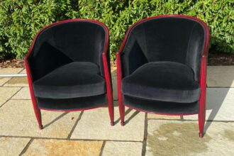 A pair of old chair frames re-polished and totally reupholstered and recovered in black velvet