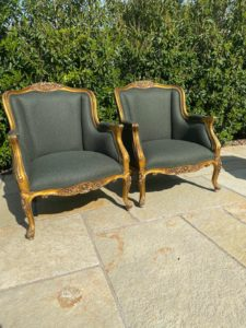 A pair of French gilt armchairs recovered in a Laura Ashley wool fabric