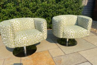 A pair of Carter chairs recovered in Leopardo Verde