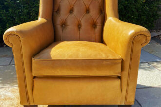 Derwent armchair recovered in Yarwood Leather