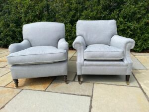 A pair of George Smith chairs recovered with new feather cushions