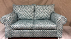 Collins and Hayes settee covered in client's own fabric