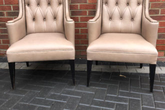 2 antique chairs recovered in leather with an individual stud finish.