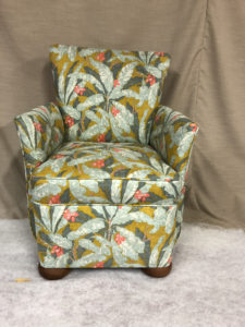 Small bedroom chair totally reupholstered in Linwood fabric