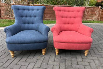 A pair of buttoned armchairs recovered in Linwood fabrics