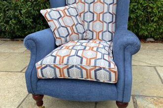 A quality winged arm chair recovered in a Fryett fabric