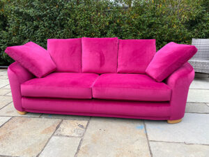 3 seated settee recovered and repaired in a magenta velvet from Sunbury Design