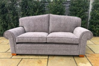 A large 3-seater Wade settee recovered and reupholstered in grey chenille - with brand-new seat and cushions