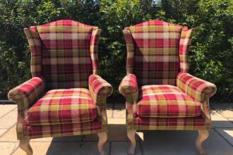 A pair of old wing back chairs recovered and reupholstered - Fordingbridge