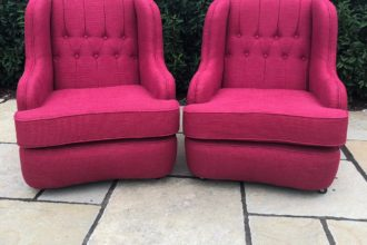 A pair of vintage Wade armchairs completely stripped back and reupholstered/recovered in a Laura Ashley fabric