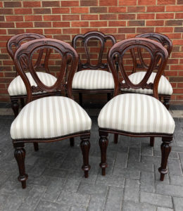 A set of antique reproduction dining chairs fully reupholstered and recovered