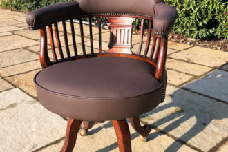 A very old captains chair, totally restored and recovered in brown leather