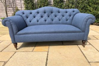 Edwardian buttoned settee completely reupholstered and recovered with new springs in blue herringbone wool